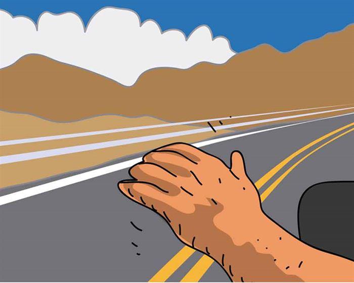 Mano en la carretera